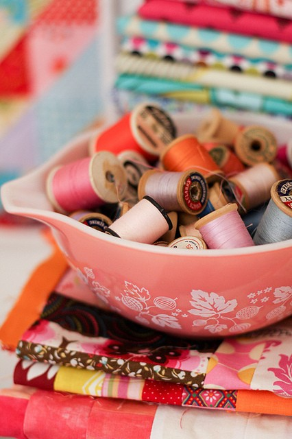 Pink Pyrex Bowl Full of Spools - An Eclectic Office or Craft Room - 15 Great Examples of Fun and Vintage Office Organizing Ideas